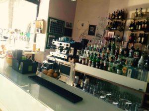 L'interno del bar di Brescia con la macchina da caffè